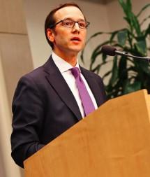 Evan-at-Brookings-podium-2-215x253