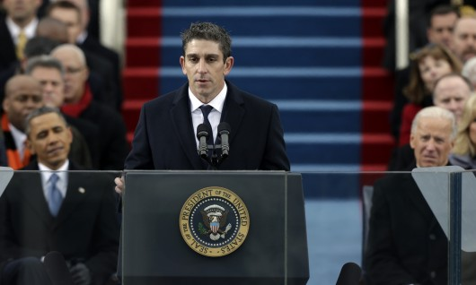 President Barack Obama, left, and Vice President Joe Biden listen as poet Richard Blanco speaks at the ceremonial swearing-in on the West Front of the U.S. Capitol during the 57th Presidential Inauguration in Washington, Monday, Jan. 21, 2013. (AP Photo/Pablo Martinez Monsivais)